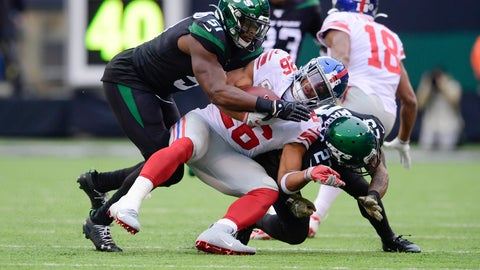 <p>               New York Jets' Brandon Copeland (51) and Arthur Maulet (23) tackle New York Giants' Saquon Barkley (26) during the second half of an NFL football game Sunday, Nov. 10, 2019, in East Rutherford, N.J. (AP Photo/Steven Ryan)             </p>