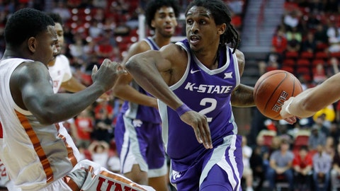 <p>               Kansas State's Cartier Diarra (2) drives into UNLV's Amauri Hardy during the second half of an NCAA college basketball game Saturday, Nov. 9, 2019, in Las Vegas. (AP Photo/John Locher)             </p>