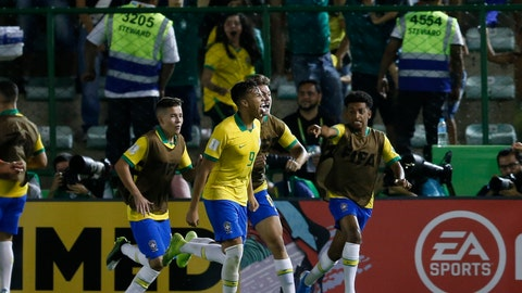 <p>               Brazil's Kaio Jorge, center, celebrates with teammates after scoring his side's first goal against Mexico during the FIFA U-17 World Cup Brazil 2019 final soccer match at Arena Bezerrao in Brasilia, Brazil, Sunday, Nov. 17, 2019. (AP Photo/Eraldo Peres)             </p>