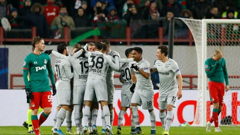 <p>               Leverkusen's players celebrate after scoring the second goal during the Champions League Group D soccer match between Lokomotiv Moscow and Leverkusen at the Lokomotiv Stadium in Moscow, Russia, Tuesday, Nov. 26, 2019. (AP Photo/Alexander Zemlianichenko)             </p>