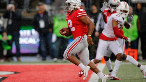 <p>               Ohio State running back J.K. Dobbins, left, scores a touchdown against Wisconsin during the second half of an NCAA college football game Saturday, Oct. 26, 2019, in Columbus, Ohio. Ohio State beat Wisconsin 38-7. (AP Photo/Jay LaPrete)             </p>