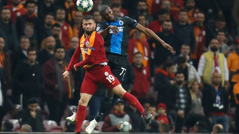 <p>               Galatasaray's Omer Bayram, left, jumps for the ball with Brugge's Amadou Sagna during the Champions League group A soccer match between Galatasaray and Club Brugge in Istanbul, Tuesday, Nov. 26, 2019. (AP Photo/Lefteris Pitarakis)             </p>