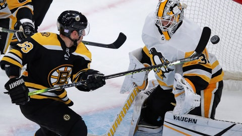 <p>               Boston Bruins center Brad Marchand (63) tips the puck past Pittsburgh Penguins goaltender Matt Murray for a goal during the first period of an NHL hockey game in Boston, Monday, Nov. 4, 2019. (AP Photo/Charles Krupa)             </p>