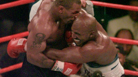 <p>               FILE - This June 28, 1997, file photo shows Mike Tyson biting into the ear of Evander Holyfield in the third round of their WBA heavyweight match in Las Vegas. Violence is part of the game in many sports. But when the Cleveland's Myles Garrett ripped the helmet off Mason Rudolph and hit the Pittsburgh Steelers' quarterback in the head with it, the Browns' defender crossed a line _ one that attracts the attention of authorities sometimes from within their sport and in other cases from criminal prosecutors.(AP Photo/Jack Smith, File)             </p>
