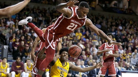 <p>               Oklahoma's Kristian Doolittle (21) loses his balance while defending against Minnesota's Marcus Carr (5) during the second half of an NCAA college basketball game in Sioux Falls, S.D., Saturday, Nov. 9, 2019. (AP Photo/Nati Harnik)             </p>