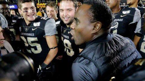 <p>               Vanderbilt head coach Derek Mason celebrates with his team, including Mitchell Pryor (25) and Scott Meyer (59), after Vanderbilt upset Missouri in an NCAA college football game Saturday, Oct. 19, 2019, in Nashville, Tenn. Vanderbilt won 21-14. (AP Photo/Mark Humphrey)             </p>