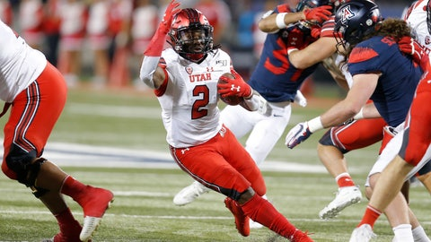<p>               Utah running back Zack Moss (2) runs for a first down against Arizona during the first half of an NCAA college football game Saturday, Nov. 23, 2019, in Tucson, Ariz. (AP Photo/Rick Scuteri)             </p>