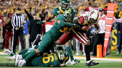 <p>               Oklahoma wide receiver Theo Wease (10) scores a 19-yard touchdown as Baylor linebacker Jordan Williams (38) defends during the second half of an NCAA college football game in Waco, Texas, Saturday, Nov. 16, 2019. Oklahoma won 34-31. (AP Photo/Ray Carlin)             </p>