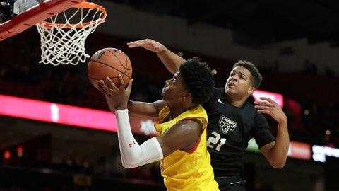 <p>               Maryland guard Hakim Hart, left, goes up for a shot as Oakland guard Madison Monroe (21) defends during the second half of an NCAA college basketball game, Saturday, Nov. 16, 2019, in College Park, Md. Maryland won 80-50. (AP Photo/Julio Cortez)             </p>