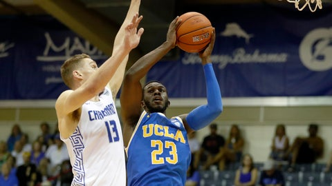 <p>               Chaminade guard Tyler Cartaino (13) tries to block UCLA guard Prince Ali (23) during the first half of an NCAA college basketball game Tuesday, Nov. 26, 2019, in Lahaina, Hawaii. (AP Photo/Marco Garcia)             </p>