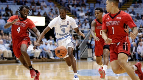 <p>               North Carolina's Brandon Robinson (4) chases the ball with Winston-Salem State's Jaylen Alston (4), Justice Kithcart (0) and Robert Colon (1) during the first half of an NCAA exhibition college basketball game in Chapel Hill, N.C., Friday, Nov. 1, 2019. (AP Photo/Gerry Broome)             </p>
