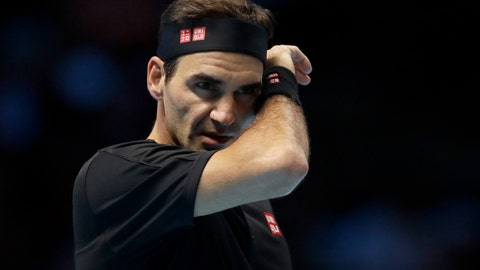 <p>               Roger Federer of Switzerland wipes his face after he plays a return to Stefanos Tsitsipas of Greece during their ATP World Tour Finals semifinal tennis match at the O2 Arena in London, Saturday, Nov. 16, 2019. (AP Photo/Kirsty Wigglesworth)             </p>