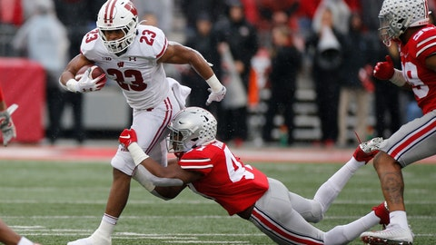 <p>               Wisconsin running back Jonathan Taylor, left, tries to cut up field past Ohio State linebacker Justin Hilliard during the first half of an NCAA college football game Saturday, Oct. 26, 2019, in Columbus, Ohio. (AP Photo/Jay LaPrete)             </p>