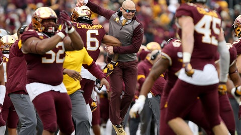 <p>               Minnesota head coach P.J. Fleck, center, jumps in celebration with defensive back Chris Williamson after the defense stopped the ball against Penn State during an NCAA college football game Saturday, Nov. 9, 2019, in Minneapolis. Minnesota won 31-26. (AP Photo/Stacy Bengs)             </p>