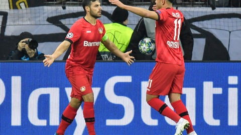 <p>               Leverkusen's Kevin Volland, left, celebrates with Leverkusen's Nadiem Amiri, right, after he scored his side's second goal during the Champions League, Group D, soccer match between Leverkusen and Atletico Madrid at the BayArena in Leverkusen, Germany, Wednesday, Nov. 6, 2019. (AP Photo/Martin Meissner)             </p>