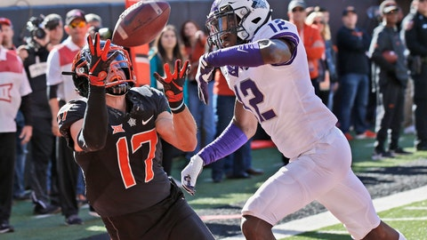 <p>               Oklahoma State wide receiver Dillon Stoner (17) catches a pass for a touchdown in front of TCU cornerback Jeff Gladney (12) in the first half of an NCAA college football game in Stillwater, Okla., Saturday, Nov. 2, 2019. (AP Photo/Sue Ogrocki)             </p>