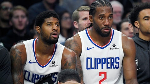 <p>               Los Angeles Clippers forward Paul George, left, and forward Kawhi Leonard sit on the bench during the second half of the team's NBA basketball game against the Boston Celtics on Wednesday, Nov. 20, 2019, in Los Angeles. (AP Photo/Mark J. Terrill)             </p>