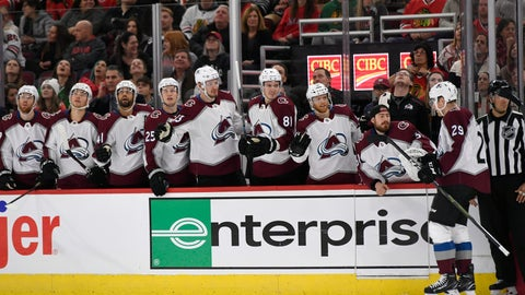 <p>               Colorado Avalanche Nathan MacKinnon (29) celebrates with teammates on the bench after scoring during the first period of an NHL hockey game against the Chicago Blackhawks Friday, Nov. 29, 2019, in Chicago. (AP Photo/Paul Beaty)             </p>