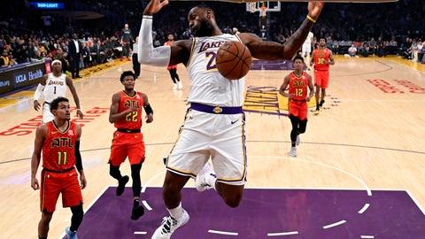 <p>               Los Angeles Lakers' LeBron James (23) dunks against Atlanta Hawks during the first half of an NBA basketball game, Sunday, Nov. 17, 2019, in Los Angeles. (AP Photo/Ringo H.W. Chiu)             </p>