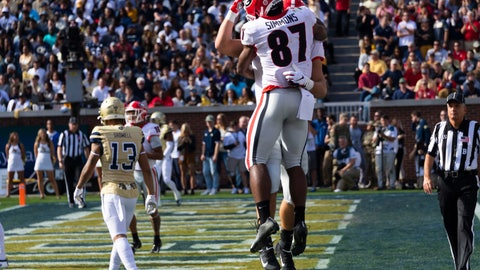 <p>               Georgia wide receiver Tyler Simmons (87) celebrates a touchdown with tight end Charlie Woerner during the first half of an NCAA college football game against Georgia Tech, Saturday, Nov. 30, 2019 in Atlanta. Woerner scored on the play. (AP Photo/John Amis)             </p>