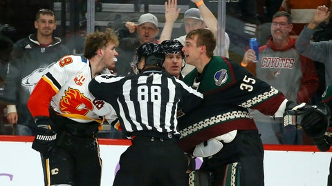 <p>               Linesman Tyson Baker (88) tries to break up Calgary Flames left wing Matthew Tkachuk, left, and Arizona Coyotes goaltender Darcy Kuemper (35) during a brawl during the second period of an NHL hockey game, Saturday, Nov. 16, 2019, in Glendale, Ariz. (AP Photo/Ross D. Franklin)             </p>