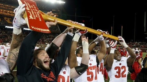 <p>               FILE - In this Nov. 25, 2017, file photo, Wisconsin players hold up Paul Bunyan's Axe up after winning 31-0 against Minnesota in an NCAA college football game, in Minneapolis. More than Paul Bunyan's Axe is on the line in college football's most-played rivalry. The winner of Saturday's game between No. 9 Minnesota and No. 13 Wisconsin wins a division title, and plays No. 2 Ohio State in the Big Ten title game. (AP Photo/Stacy Bengs, File)             </p>