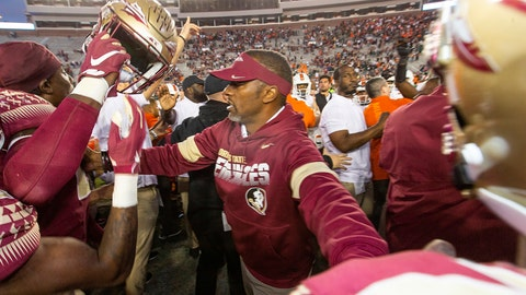 <p>               Florida State head coach Willie Taggart tries to keep his team from interacting with the Miami team after Miami beat Florida State 27-10 in an NCAA college football game in Tallahassee, Fla., Saturday, Nov. 2, 2019. Florida State fired second-year football coach Willie Taggart on Sunday, Nov. 3, less than 24 hours after the Seminoles lost to rival Miami and with the team in danger of missing a bowl game for the second consecutive season. (AP Photo/Mark Wallheiser)             </p>
