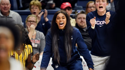 <p>               Connecticut's Evina Westbrook, center, cheers for her team from the bench during the second half of a women's NCAA college basketball game against California, Sunday, Nov. 10, 2019, in Storrs, Conn. Westbrook, a transfer student, was denied immediate eligibility by the NCAA to play this season. UConn is appealing the decision. (AP Photo/Stephen Dunn)             </p>