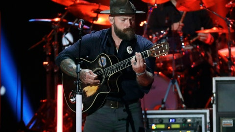 "<p>               FILE - In this June 5, 2019, file photo, Zac Brown performs at the CMT Music Awards in Nashville, Tenn. The Zac Brown Band is going to lend its sound to the NFL. The Atlanta-based group will give its 2008 hit ""Chicken Fried"" a holiday twist for the Thanksgiving night matchup between the hometown Falcons and rival New Orleans Saints. (AP Photo/Mark Humphrey, File)             </p>"