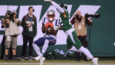 <p>               New England Patriots' Phillip Dorsett, left, catches a pass for a touchdown in front of New York Jets' Trumaine Johnson during the first half of an NFL football game Monday, Oct. 21, 2019, in East Rutherford, N.J. (AP Photo/Bill Kostroun)             </p>