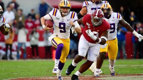 <p>               LSU quarterback Joe Burrow (9) runs as Alabama defensive lineman Phidarian Mathis (48) chases him in the first half of an NCAA college football game, Saturday, Nov. 9, 2019, in Tuscaloosa , Ala. (AP Photo/Vasha Hunt)             </p>