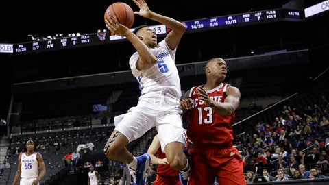 <p>               Memphis' Boogie Ellis (5) shoots over North Carolina State's C.J. Bryce (13) during the first half of an NCAA college basketball game in the Barclays Classic, Thursday, Nov. 28, 2019, in New York. (AP Photo/Frank Franklin II)             </p>