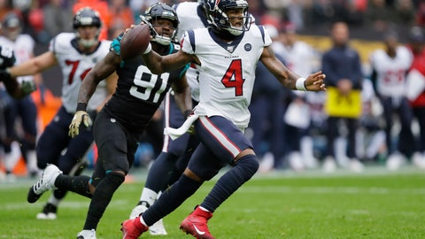 <p>               Houston Texans quarterback Deshaun Watson (4) runs out of the pocket under pressure by Jacksonville Jaguars defensive end Yannick Ngakoue (91) during the first half of an NFL football game at Wembley Stadium, Sunday, Nov. 3, 2019, in London. (AP Photo/Kirsty Wigglesworth)             </p>