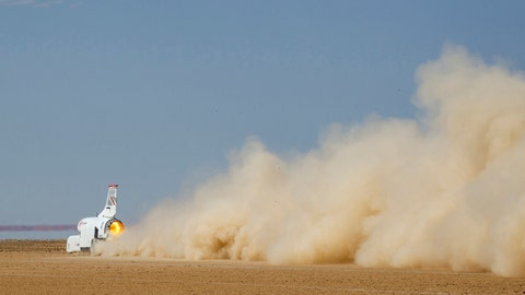 <p>               In this handout photo provided by Bloodhound, the vehicle speeds along the Hakskeenpan track in South Africa during trials to set a land speed record Friday, Nov. 8, 2019. Hitting 501 miles per hour on the South Africa's northern desert, the Bloodhound became one of the world's 10 fastest cars this week, on target for its goal to set a new land speed record. A jet that stays on earth, Bloodhound's next goal is to reach 550 miles per hour, possibly in the coming week. (Charlie Sperring/Bloodhound via AP)             </p>