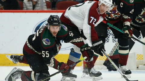 <p>               Arizona Coyotes defenseman Jason Demers (55) looks to control the puck as he collides with Colorado Avalanche right wing Joonas Donskoi (72) during the second period of an NHL hockey game Saturday, Nov. 2, 2019, in Glendale, Ariz. (AP Photo/Ross D. Franklin)             </p>