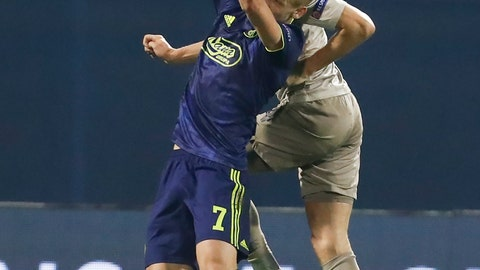 <p>               Dinamo Zagreb's Dani Olmo, left, and Shakhtar's Serhiy Kryvtsov head the ball during the group C Champions League soccer match between Dinamo Zagreb and Shakhtar Donetsk at Maksimir Stadium in Zagreb, Croatia, Wednesday, Nov. 6, 2019. (AP Photo/Darko Bandic)             </p>