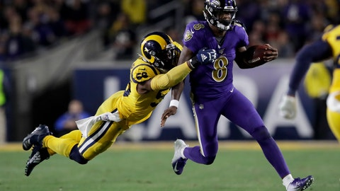 <p>               Baltimore Ravens quarterback Lamar Jackson, right, is tackled by Los Angeles Rams defensive end Dante Fowler during the second half of an NFL football game Monday, Nov. 25, 2019, in Los Angeles. (AP Photo/Marcio Jose Sanchez)             </p>