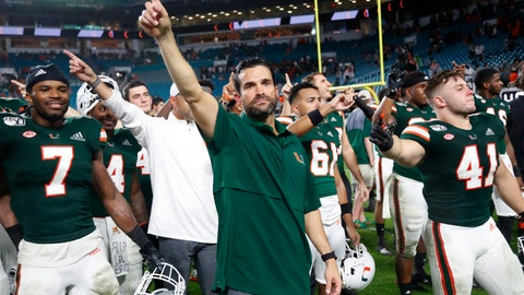 <p>               Miami coach Manny Diaz, center, celebrates with players after Miami defeated Louisville 52-27 during an NCAA college football game Saturday, Nov. 9, 2019, in Miami Gardens, Fla. (AP Photo/Wilfredo Lee)             </p>