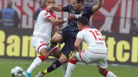 <p>               Duesseldorf's Alfredo Morales, left, and Erik Thommy, right, challenge for the ball with Cologne's Louis Schaub, center, during the German Bundesliga soccer match between Fortuna Duesseldorf and 1.FC Cologne in Duessledorf, Germany, Sunday, Nov. 3, 2019.  (Roland Weihrauch/dpa via AP)             </p>
