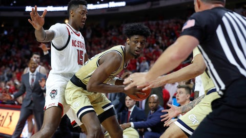 <p>               Georgia Tech's Khalid Moore (12) pulls in a loose ball after North Carolina State's Devon Daniels tried to throw the ball to Manny Bates (15) with less than 10 seconds left in an NCAA college basketball game Tuesday, Nov. 5, 2019, in Raleigh, N.C. (Ethan Hyman/The News & Observer via AP)             </p>