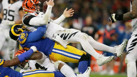 <p>               Cincinnati Bengals quarterback Andy Dalton, top, is sacked by Los Angeles Rams defensive tackle Aaron Donald during the second half of an NFL football game, Sunday, Oct. 27, 2019, at Wembley Stadium in London. (AP Photo/Tim Ireland)             </p>