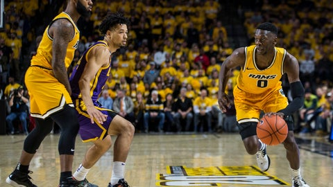 <p>               Virginia Commonwealth guard De'Riante Jenkins (0) drives around LSU guard Skylar Mays (4) during the first half of an NCAA college basketball game in Richmond, Va., Wednesday, Nov. 13, 2019. (AP Photo/Zach Gibson)             </p>
