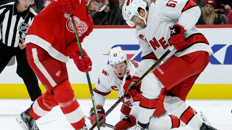 <p>               Detroit Red Wings center Andreas Athanasiou, left, battles with Carolina Hurricanes defenseman Trevor van Riemsdyk (57) and center Eetu Luostarinen (43) for the puck during the second period of an NHL hockey game Sunday, Nov. 24, 2019, in Detroit. (AP Photo/Duane Burleson)             </p>