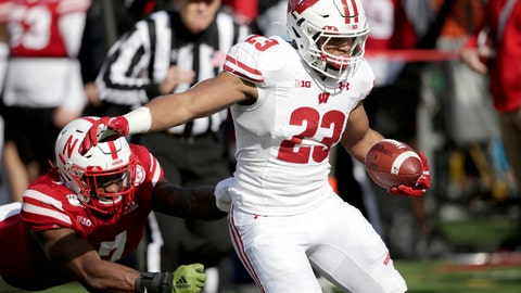 <p>               Wisconsin running back Jonathan Taylor (23) carries the ball away from Nebraska linebacker Mohamed Barry, left, during the first half of an NCAA college football game in Lincoln, Neb., Saturday, Nov. 16, 2019. (AP Photo/Nati Harnik)             </p>