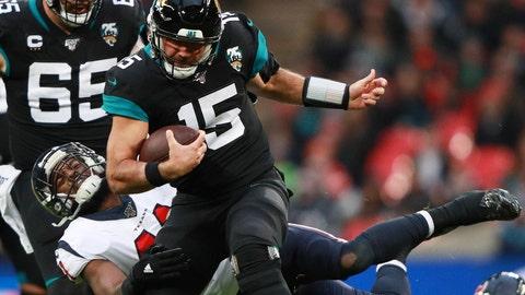 <p>               Houston Texans inside linebacker Zach Cunningham (41) tackles Jacksonville Jaguars quarterback Gardner Minshew (15) during the second half of an NFL football game at Wembley Stadium, Sunday, Nov. 3, 2019, in London. (AP Photo/Ian Walton)             </p>