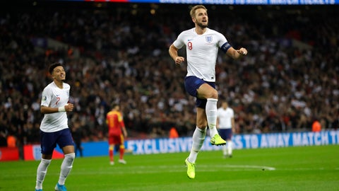 <p>               England's Harry Kane, right, celebrates scoring the fifth goal during the Euro 2020 group A qualifying soccer match between England and Montenegro at Wembley stadium in London, Thursday, Nov. 14, 2019. (AP Photo/Kirsty Wigglesworth)             </p>