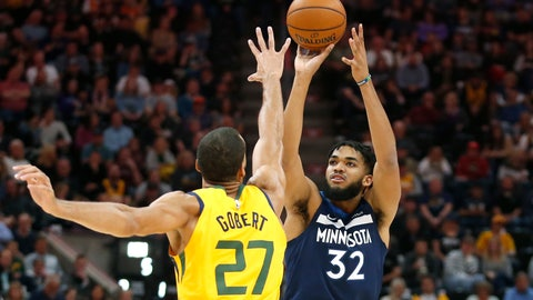 <p>               Minnesota Timberwolves center Karl-Anthony Towns (32) shoots as Utah Jazz center Rudy Gobert (27) defends in the first half during an NBA basketball game Monday, Nov. 18, 2019, in Salt Lake City. (AP Photo/Rick Bowmer)             </p>