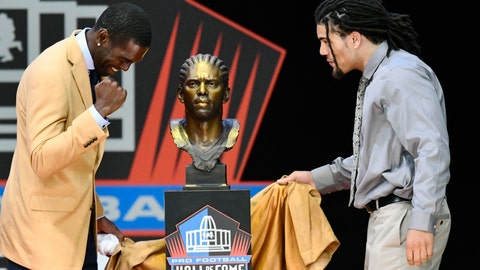 <p>               FILE - In this Aug. 4, 2018, file photo, former NFL wide receiver Randy Moss, left, unveils his bust with his presenter, son Thaddeus Moss, during induction ceremonies at the Pro Football Hall of Fame in Canton, Ohio. In the Southeastern Conference, the Manning family is just the best known example of sons following their fathers, and in many cases, grandfathers into football. Turns out teams across the league have players living out their own family legacies.(AP Photo/David Richard, File)             </p>
