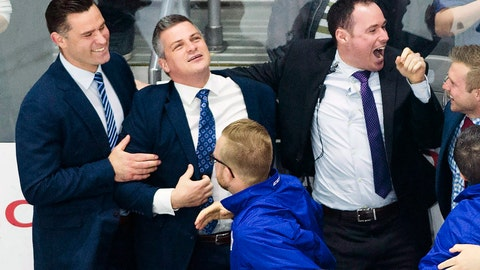<p>               In this June 14, 2018, photo, Toronto Marlies head coach Sheldon Keefe, second from left, celebrates with his coaching and training staff after defeating the Texas Stars to win the AHL Calder Cup championship in Toronto. Keefe was officially introduced Thursday morning, Nov. 21, 2019,  as the 31st head coach of the NHL hockey Toronto Maple Leafs. (Nathan Denette/The Canadian Press via AP)             </p>