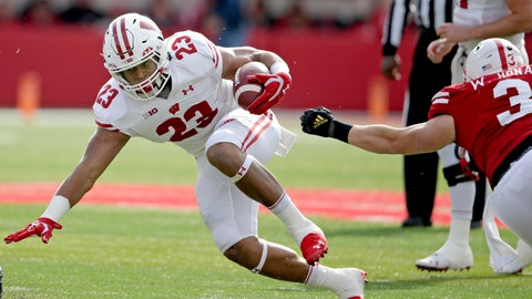 <p>               Wisconsin running back Jonathan Taylor (23) runs with the ball away from Nebraska linebacker Will Honas (3) during the first half of an NCAA college football game in Lincoln, Neb., Saturday, Nov. 16, 2019. (AP Photo/Nati Harnik)             </p>